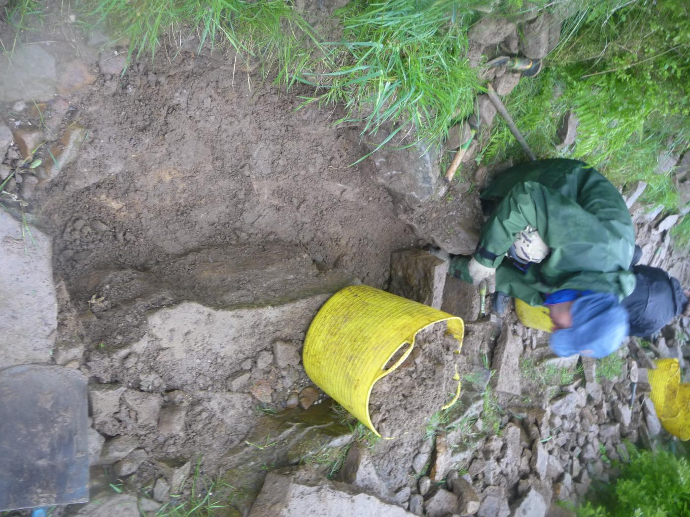 Stone pitching 1 - A hole is dug (easier said than done in stony ground)