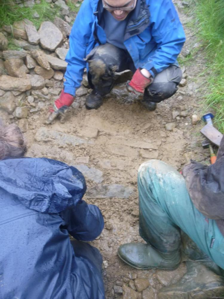 Stone pitching 4 - Top of the gaps is packed with soil to hold it all in place